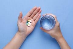 Taking pill Royalty Free Stock Photos