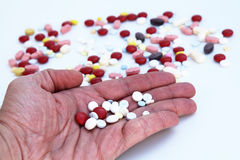 Taking pills. Taking lots of pills due to illness Royalty Free Stock Images