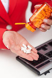 Taking pills in the office Royalty Free Stock Photos