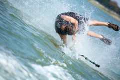 Taking the plunge. Young man on a wakeboard Stock Photo