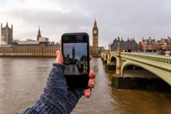 Taking and posting photo of Big ben in winter morning royalty free stock photos