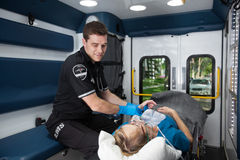 Taking Pulse in Ambulance Stock Photo