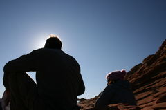 Taking A Rest. A couple resting after a hike in the desert Royalty Free Stock Photo