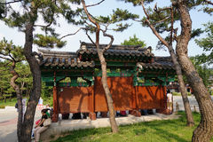 Taking a rest under the billboard. Tourists are taking a rest in front of the introduction board at the entrance of  Namsangol Hanok village or the preserved Stock Images