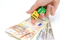 Taking a risk and winning concept with a pair of dice and money. Taking a risk and winning concept with a pair of dice and a couple of banknotes Royalty Free Stock Photos