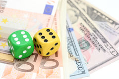 Taking a risk and winning concept with a pair of dice standing on US dollars Stock Photo