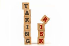 Taking Risk word written on cube shape. Stock Photography