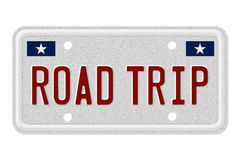 Taking a  Road Trip. Taking a road trip in the United States, The words Road Trip on a gray license plate isolated on white with the US colors and stars Royalty Free Stock Image