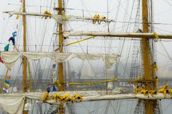 Taking in the sails of three masted ship in rain and fog Royalty Free Stock Images