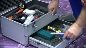 Taking the screwdriver out of the toolbox stock footage