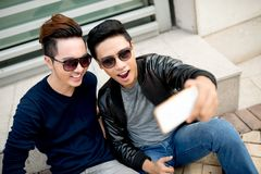 Taking selfie. Best friends in sunglasses taking selfie Stock Photo