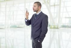 Taking selfie. Businessman in suit and tie taking selfie photo with mobile phone camera posing happy and successful at the office Royalty Free Stock Image