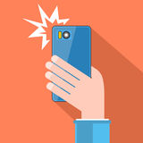 Taking selfie with flash. Hand with smartphone. Vector. Stock Photos