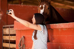 Taking a selfie with a horse Royalty Free Stock Photo