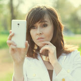Taking a selfie or shooting Royalty Free Stock Image