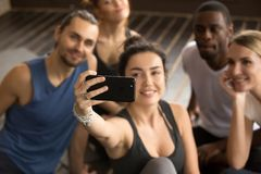 Taking selfie on smartphone concept, sporty woman making group s Royalty Free Stock Photography