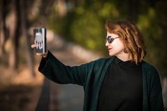 Taking Selfie Snapshot with Attitude, Woman with Smartphone at t. He Park Royalty Free Stock Images