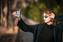 Taking Selfie Snapshot with Attitude, Woman with Smartphone. At the Park Stock Photos