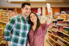 Taking selfie at the supermarket Stock Photo