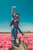 Taking selfie in tulip fields Stock Photo