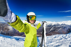 Taking selfie of woman with ski Stock Image