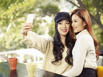 Taking selfie. Young friends taking selfie in coffee shop Stock Photography