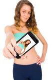 Taking Selfies is One of a Trendy Habit. Gorgeous woman smiling kindly taking a selfie with her smartphone Royalty Free Stock Photo