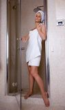 Taking shower. Girl posing in the luxurious bathroom, spa concept stock photography