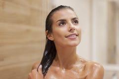 Taking shower Stock Photo