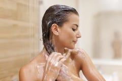 Taking shower Stock Image