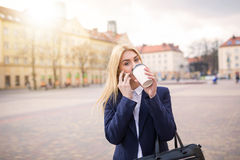 Taking a sip of coffee Royalty Free Stock Images