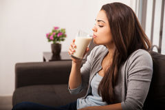 Taking a sip of milk at home Royalty Free Stock Photos