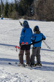 Taking the ski lift. Two kids taking the ski lift at the Baile Homorod ski resort, Romania. The low inclination slope and the low altitude make this small Royalty Free Stock Photography