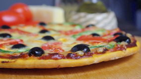 Taking slice of pizza,melted cheese drippin stock video footage
