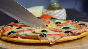 Taking slice of pizza,melted cheese drippin Stock Photo