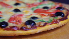 Taking slice of pizza,melted cheese drippin Stock Photography