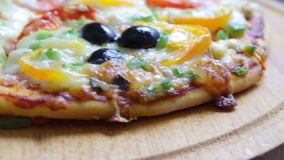 Taking slice of pizza,melted cheese drippin Royalty Free Stock Photo