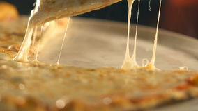 Taking slice of pizza,melted cheese dripping. Slow Motion stock video footage