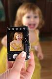 Taking snapshot of little girl Royalty Free Stock Photos