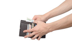 Taking some bills out of a wallet Stock Image