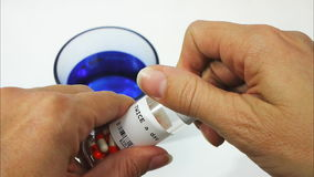 Taking some pills stock video footage