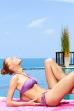 Taking sunbath in bikini Royalty Free Stock Photos