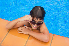 Taking sunbath by the pool Royalty Free Stock Image