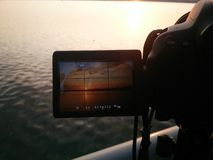 Time lapse photography. Taking time lapse photo of the sunset Royalty Free Stock Image