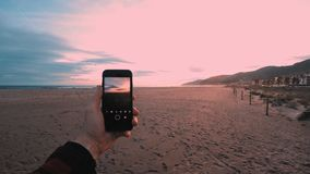 Taking sunset photos or videos stock footage