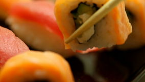 Taking sushi rolls stock footage