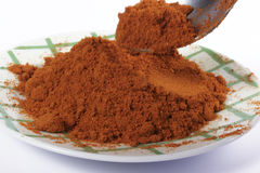 Taking a tablespoon of paprika Royalty Free Stock Photo