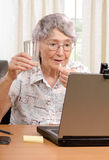 Taking tablet during unpleasant internet conversation Stock Images