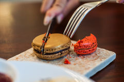 Taking tasty colorful macaroons Stock Photo