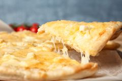 Taking tasty homemade pizza slice with melted cheese. Closeup stock photos
